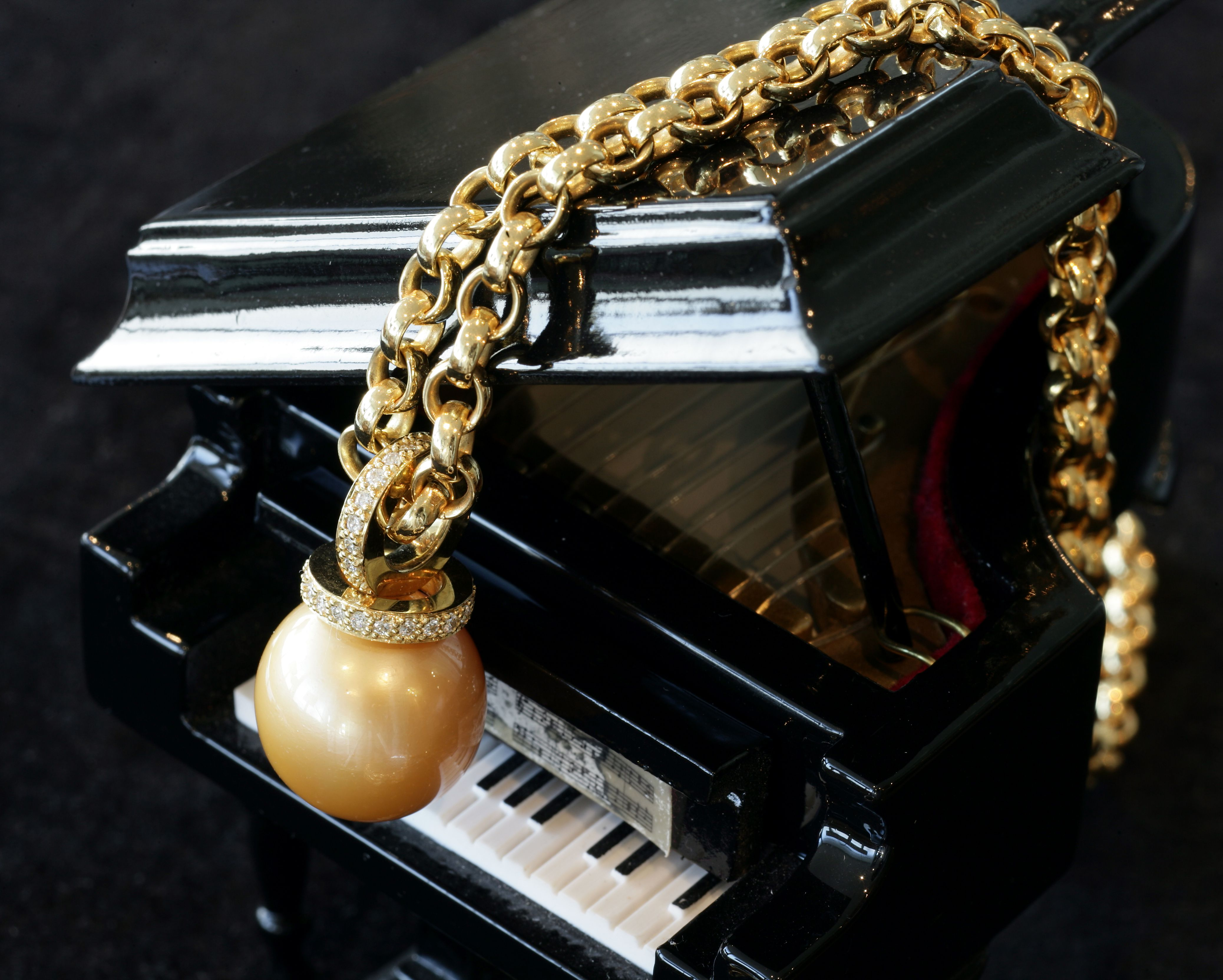 Pearl necklace on piano.jpg